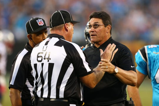 Carolina Panthers head coach Ron Rivera gets an explanation on a call by umpire Dan Ferrell (64) in the first quarter against the New England Patriots at Bank of America Stadium. Aug 24, 2018; Charlotte, NC, USA;