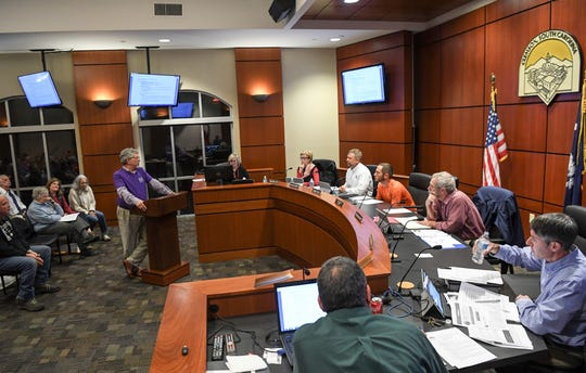 Charlie White talks about statistics from a community poll, near Crossie Cox, right, during a Clemson City Council meeting in Clemson Monday, December 2, 2019.  A presentation by the group Build a Better Clemson was made during the meeting, sparking a request to pause further approvals for development in the city.