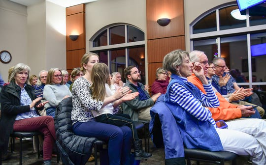 Residents applaud during a Clemson City Council meeting in Clemson Monday, December 2, 2019.  A presentation by the group Build a Better Clemson was made during the meeting, sparking a request to pause further approvals for development in the city.