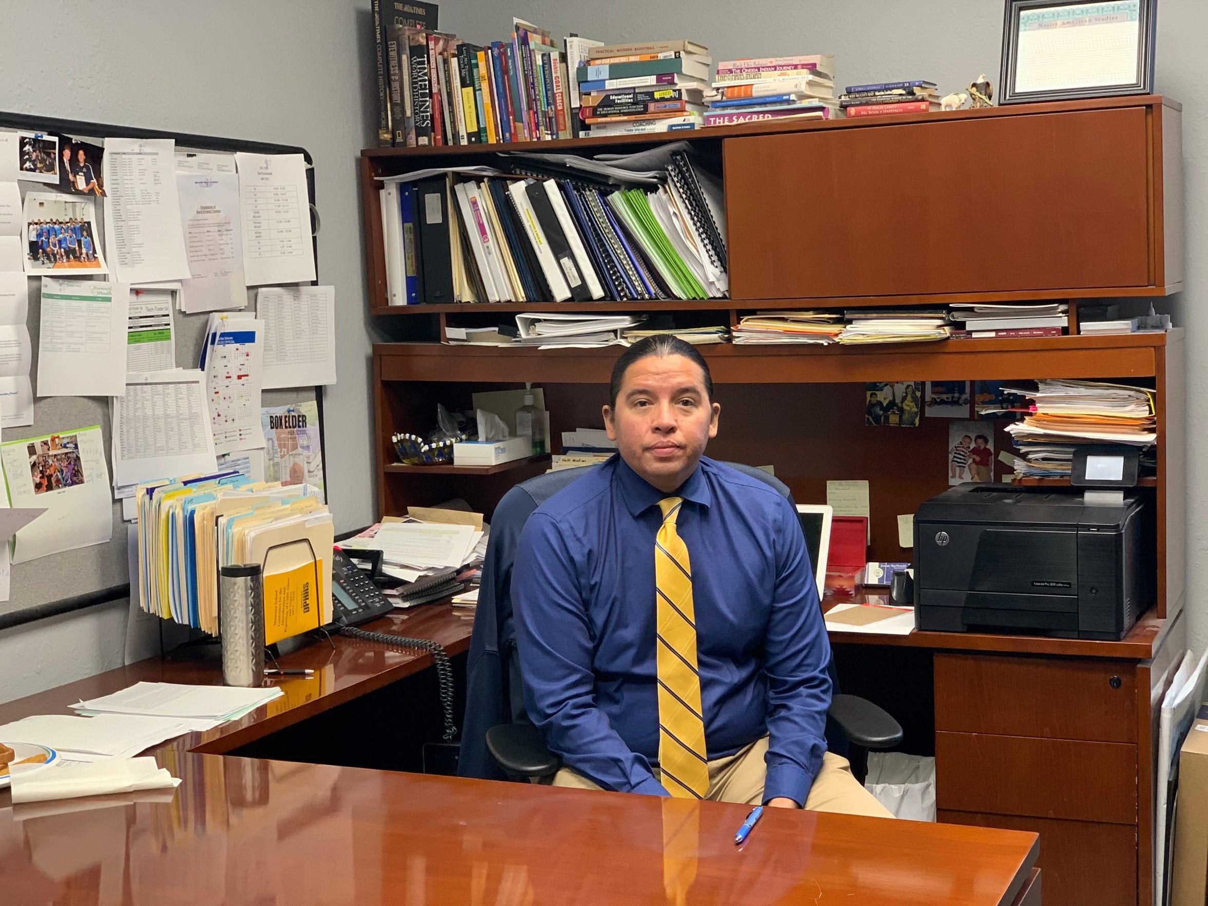 Superintendent of Box Elder School Jeremy MacDonald sits at his desk.