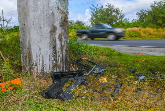 Crash debris and paint markings left behind by traffic investigators can be found at the site of an auto-pole collision on the shoulder of northbound lanes, just south of the Marine Corps Drive and Wusstig Road intersection in Dededo, on Tuesday, Dec. 3, 2019.