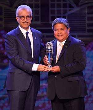Guam Football Association President Tino San Gil with Asian Football Confederation President Shaikh Salman bin Ebrahim Al Khalifa after accepting the AFC Member Association of the Year, Aspiring Category, trophy from at the AFC Annual Awards 2019 at the Hong Kong Convention and Exhibition Centre in Hong Kong.