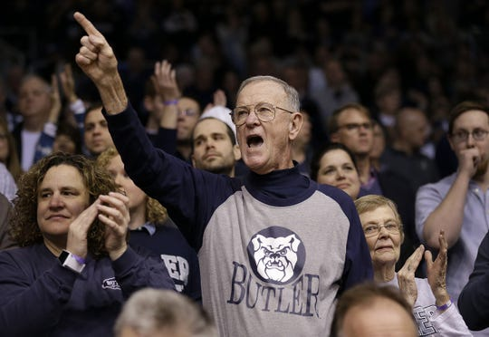Butler superfan Wally Cox, who played as freshmen with Bobby Plump in 1954-55 and now sits in the first row behind the scorer's table and cheers on his Butler Bulldogs Wednesday, Mar 2, 2016, evening at Hinkle Fieldhouse in Indianapolis. The Butler Bulldogs defeated the Seton Hall Pirates 85-78.