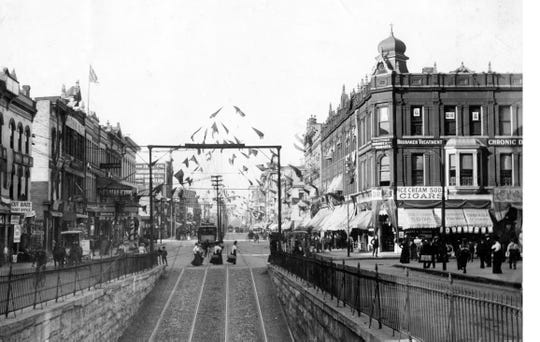 Looking north on Illinois Street from the tunnel to Union Station in 1908. The Levee, as it was known, flies flags for the 1908 election.