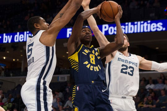 Dec 2, 2019; Memphis, TN, USA; Indiana Pacers forward Justin Holiday (8) drives to the basket against Memphis Grizzlies forward Bruno Caboclo (5) during the first half at FedExForum.