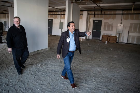 From left, Jim Strietelmeier and Dr. Javier Sevilla walk through the vacant space in the Clifford Corners building that the Indiana University Student Outreach Clinic hopes to expand to, across from its current home at Neighborhood Fellowship Church on the near east side of Indianapolis on Saturday, Nov. 16, 2019. Strietelmeier is a pastor at the church and Sevilla is medical director for the health clinic.