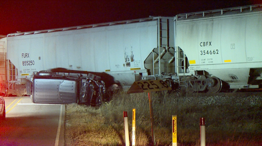One person is dead and another person is injured after two vehicles collided with the same train in Brownsburg.