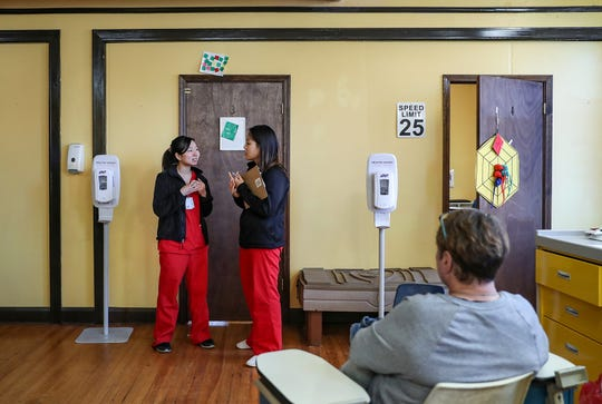 Nursing students talk near the examination rooms during the weekly Indiana University Student Outreach Clinic at Neighborhood Fellowship Church on the near east side of Indianapolis on Saturday, Nov. 16, 2019.