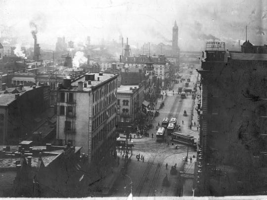 A busy thoroughfare today, Illinois Street was bustling just after the turn of the century, too. This view from 1905 is looking south toward Union Station (background) from the Washington Street intersection.