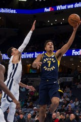 Dec 2, 2019; Memphis, TN, USA; Indiana Pacers guard Malcolm Brogdon (7) drives to the basket against Memphis Grizzlies guard Tyus Jones (21) during the first half at FedExForum.
