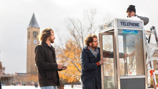 Chris Hoff, left, and Sam Harnett install a listening booth on the Cornell Arts Quad for World According to Sound.