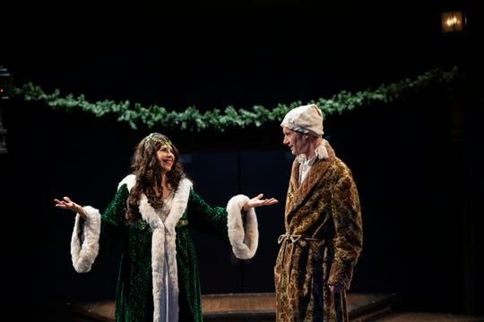Sally G. Ramírez (Christmas Present) and Curzon Dobell (Ebenezer Scrooge) star in 'A Christmas Carol' at Ithaca's Hangar Theatre.