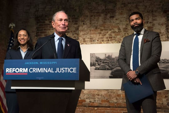 2020 U.S. presidential candidate, and former New York City Mayor, Michael Bloomberg (center) spoke with members of the press following a round-table on criminal justice reform led by Jackson, Mayor Chokwe Lumumba (far right) at the Smith Robertson Museum in downtown Jackson, Mississippi on Tuesday, December 3, 2019.  Jennifer Jones Austin (far left),  NYC Department of Correction Board Member, also attended the roundtable.
