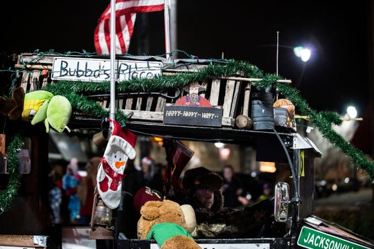 Spectators gathered in downtown Jackson, Tenn., to watch local organization's floats, high school bands and dance groups participate in the Christmas parade, Monday, Dec. 2, 2019.