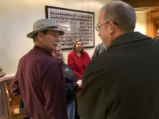 Stan Kyger, left, talks with his attorney, Peter Kovacs, after Tippecanoe Circuit Judge Sean Persin declared him the winner of his Dayton Town Council race on Tuesday, Dec. 3, 2019. Kyger sued Tyrone Taylor, the town council president he beat him on Nov. 5, claiming a past felony conviction made Taylor ineligible to be on the ballot.