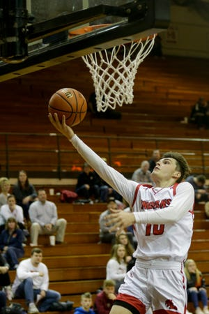 Twin Lakes' Noah Johnston (10) goes up for a layup during the second quarter of game two of the 2019 Boys Hoops Classic, Monday, Dec. 2, 2019 in Lafayette.