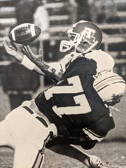 Ed Orgeron making a tackle at Northwestern State University.