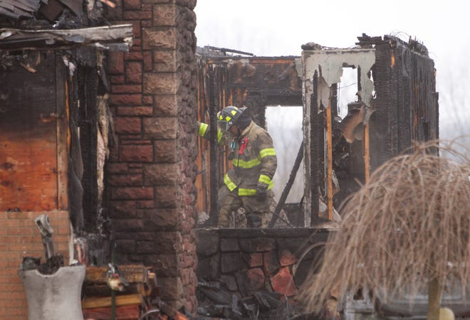 Firefighters from Fowlerville, Unadilla, Howell and Leroy fire departments battled a fire at a home on Fowlerville Road Tuesday, Dec. 3, 2019.