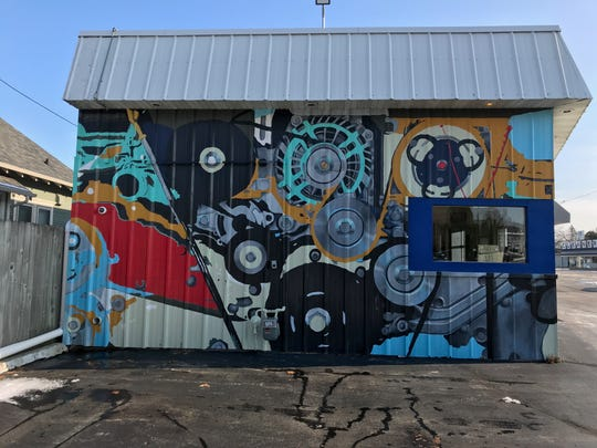 This mural at Novak's Service Center combines art and machinery. It can be seen from Washington Street.