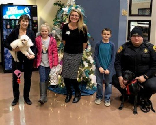 Marion County Auditor Joan Kasotis holding Princess Pickles, Chole Brugler, Clerk of Court Jessica Wallace, Top Dog winner Brody Dehaven, Dog Warden Scott Mills with Top Dog Niko