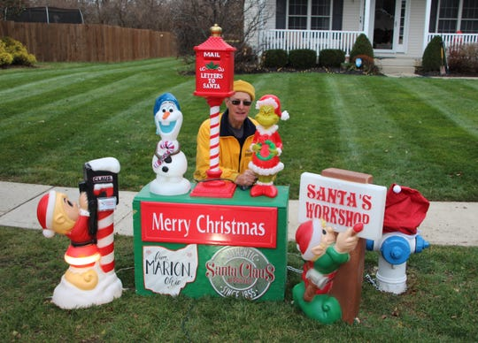 Bob Styer puts the finishing touches on the letters to Santa decoration that is part of the 2019 A Christmas House display. His son, Michael Styer, said Bob was his inspiration for A Christmas House.