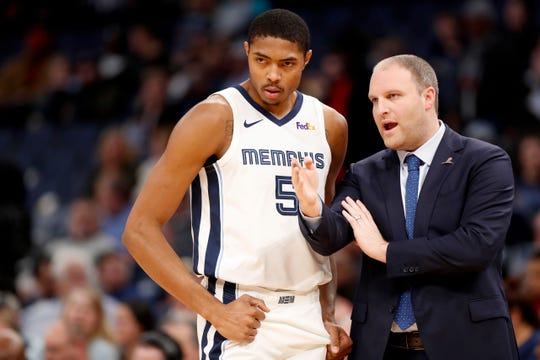 Grizzlies' head coach Taylor Jenkins talks with Bruno Caboclo (5) on Monday, Dec. 2, 2019, during a game against the Pacers at FedExForum in downtown Memphis.