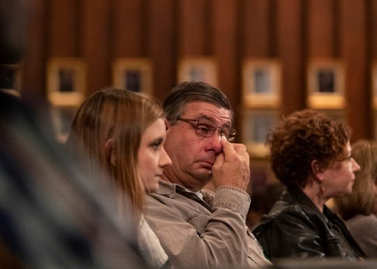 A man tears up during the 9th annual Season of Remembrance memorial event honoring homicide victims and their families at Memphis City Hall on Monday, Dec. 2, 2019.