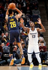 Pacers' Jeremy Lamb (26) looks to shoot over Jaren Jackson Jr. on Monday, Dec. 2, 2019, during a game at FedExForum in downtown Memphis.