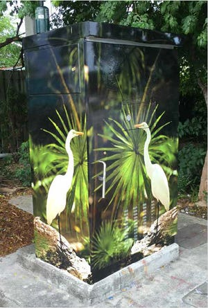 A utility box is wrapped by art