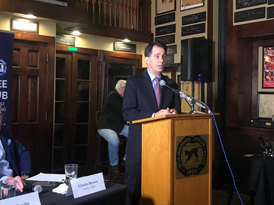 Former Gov. Scott Walker speaking Monday at the Milwaukee Press Club.