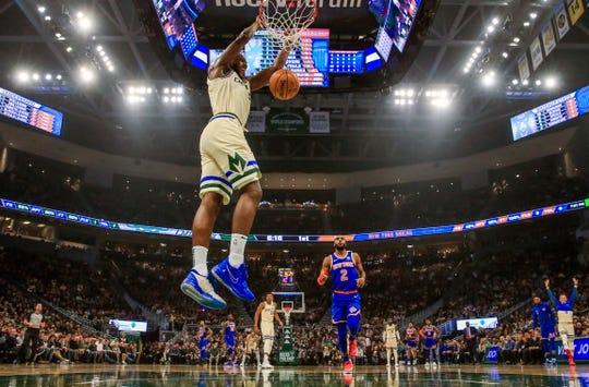 Bucks forward Khris Middleton scores against the New York Knicks during a game Dec. 2.