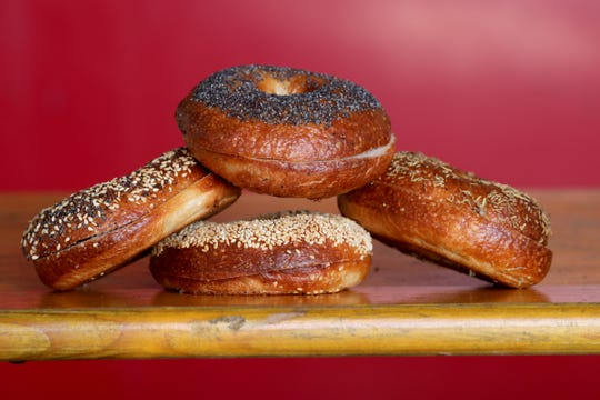 Bagels at Ruby's Bagels include, clockwise from left, everything, poppy seed, rosemary sea salt and sesame seed bagels. Ruby's is in a freestanding building at the Zocalo food truck park in Walker's Point, 636 S. Sixth St.