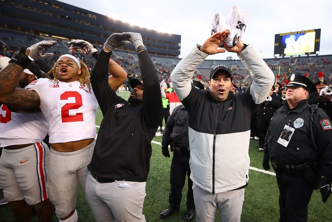 Ohio State head coach Ryan Day joins in the celebration of the Buckeyes' celebration of a 56-27 win over the Michigan on Saturday.