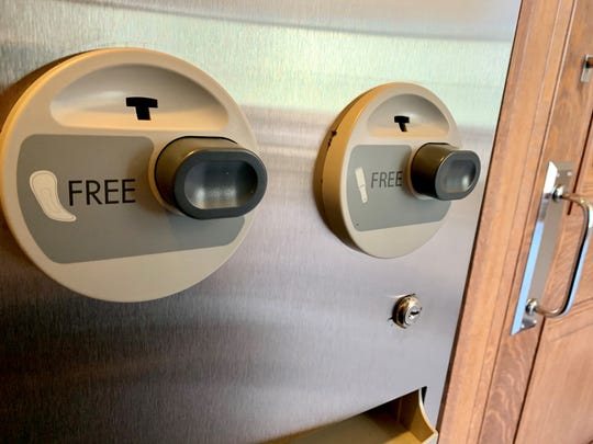 Women's restrooms in state buildings will be outfitted with free feminine hygiene product dispensers like this one in a restroom at the Wisconsin State Capitol.