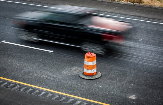 A truck passes a traffic cone on I-69 north near Anderson Tuesday.