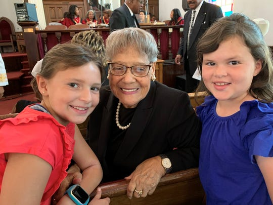 Biola Jordan (middle) attendedDexter Avenue King Memorial Baptist Church, where Dr. Martin Luther King, Jr. preached 64 years ago whenRosa Parks sat in the audience to hear one of his sermons. Charlotte Uribe (right), 7, attends the church service with her sister Lauren Uribe, 9, where they met Jordan.