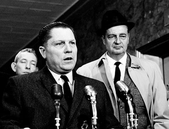 Teamster Union President Jimmy Hoffa, left, with one of his attorneys, Z.T. Osborn of Nashville by his side, speaks to the media after his $1 million conspiracy trial ended in a mistrial when the jury reported for the fourth time that it was hopelessly deadlocked Dec. 23, 1962. Hoffa told reporters he grateful for the outcome, but surprised that the jury did not return a not guilty verdict.