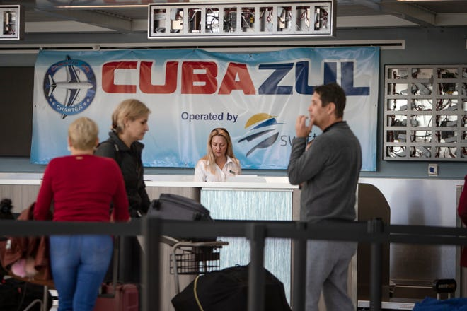 Cubazul passengers wait in line at Southwest Florida International Airport on Tuesday, Dec. 3, 2019, in Fort Myers.