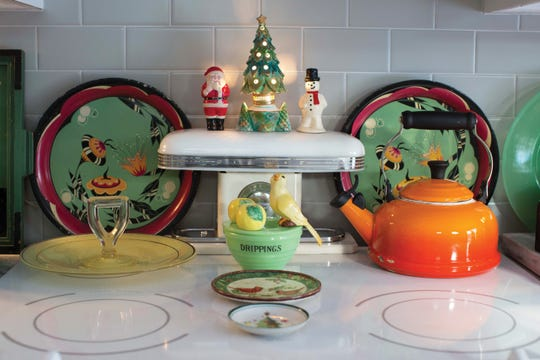 A vintage Christmas tree nightlight sits atop the stove.