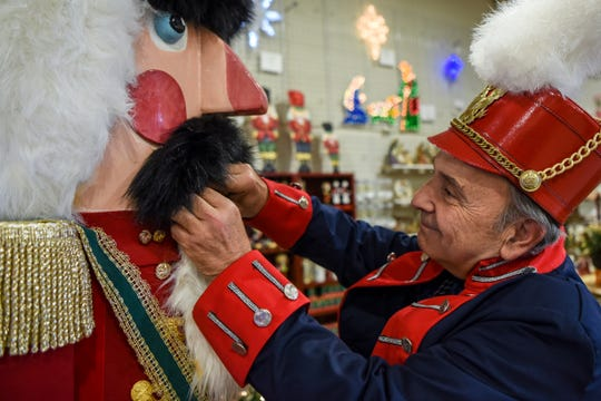 Mike Perrone, the president of the Belleville Historical Society, built an eight foot tall working nutcracker which is on display at State Fair Seasons in Belleville  along with a donation bucket to raise funds for 1st Cerebral Palsy of New Jersey. Perrone loads walnuts into the mouth of the nutcracker on Tuesday December 3, 2019.