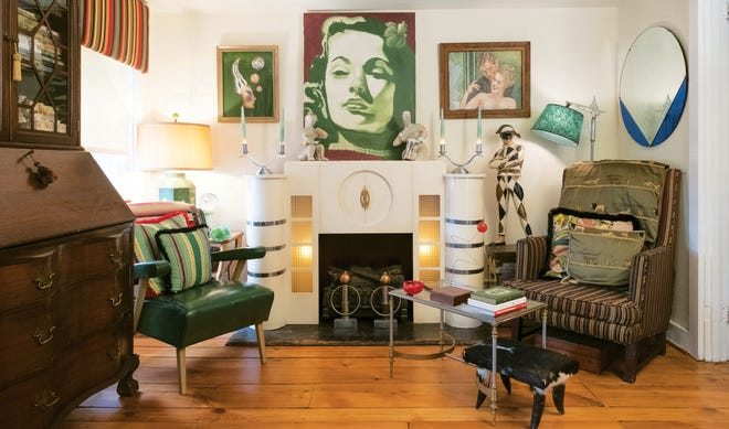 Moved from his New York City apartment to his new, small town home, treasured objects, like the painting of favorite actress Gene Tierney by artist and friend Sioux Krause and the Art Deco glass block and chrome mantel, reside in Bob Richter's TV room, which is personalized with two chairs passed down, respectively, from family and his antiques mentor.
