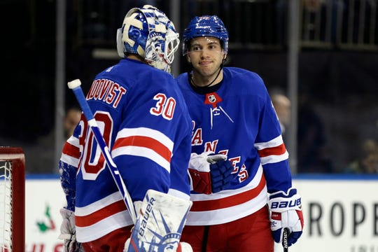 New York Rangers defenseman Tony DeAngelo (77) and goaltender Henrik Lundqvist (30) react after a goal by Vegas Golden Knights right wing Alex Tuch during the first period at Madison Square Garden.