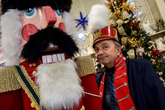 Mike Perrone, the president of the Belleville Historical Society, built an eight foot tall working nutcracker which is on display at State Fair Seasons in Belleville  along with a donation bucket to raise funds for 1st Cerebral Palsy of New Jersey. Perrone poses for a photo with the nutcracker on Tuesday December 3, 2019.