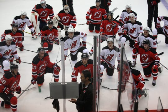 Assistant Coach, Alain Nasreddine instructs players on Monday in Newark. Monday was the first day of the 2015 Devils Development Camp.  They are shown at the practice rink at the Prudential Center in Newark.
