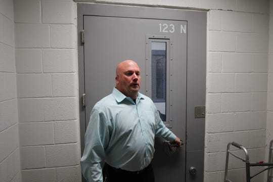 Eddy County Detention Center Warden Billy Massingill gets ready to take Eddy County Commissioners and administrators on a tour of the jails main building Dec. 3 in Carlsbad.
