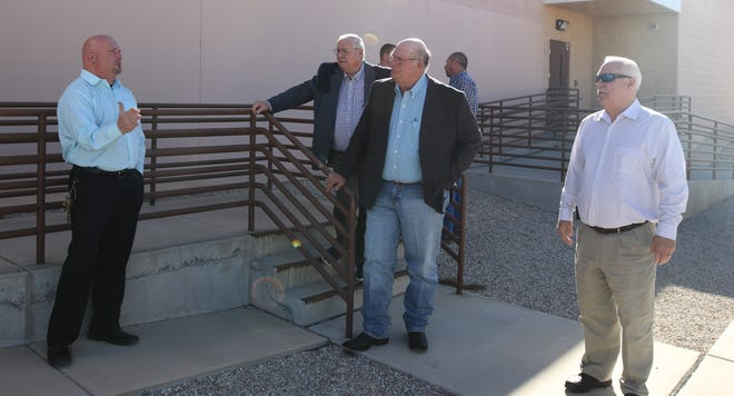 From left:Eddy County Detention Center Warden Billy Massingill, District 3 Eddy County Commissioner Larry Wood, District 1 County Commissioner Ernie Carlson and Eddy County Government Affairs Director Jerry Fanning discuss inner workings of the jail Dec. 3 in Carlsbad.