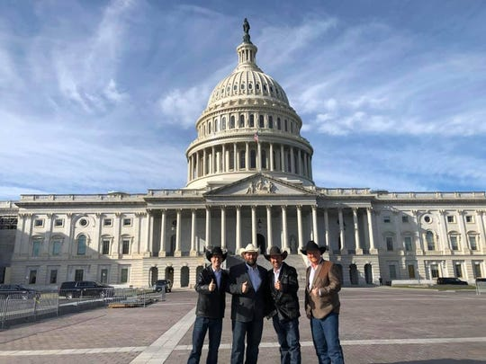 Representatives from the Cowboys for Trump organization stand outside the U.S. Capitol building during a trip to Washington, D.C. for the Congressional Tree Lighting Dec. 4.