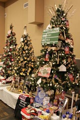 A baseball-themed tree is among the offerings at this year's Festival of Trees in the Farmington Civic Center.