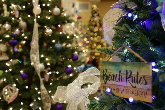 This tree in the Festival of Trees at the Farmington Civic Center celebrates beach life, and it's up for auction on Dec. 7. The money goes to charity.