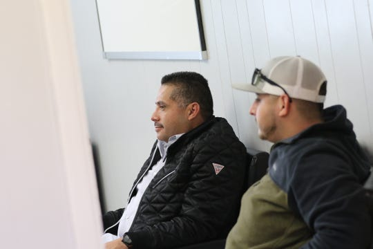 Enrique Gama, left, and Enrique Gama Jr., right, on Dec. 3 at the offices of Gama Transport in Carlsbad, New Mexico. The father and son are part of the family owned business which has prospered in the oil and gas industry but remained committed to helping their community grow.